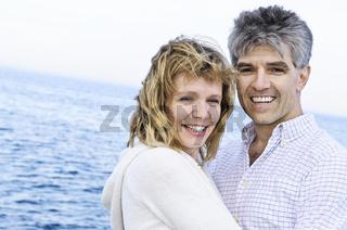 Mature romantic couple at seashore