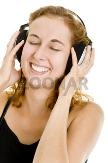 Grinsend Musik hören