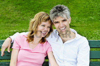 Mature romantic couple on a bench