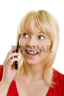 Freudig erstaunt beim Telefonat