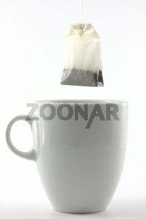 tea bag and a white mug