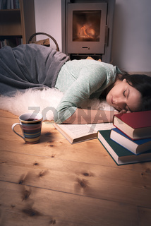 Sleeping girl surrounded by books
