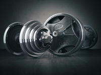 Barbell and dumbell. Sports bodybuilding equipment on black background. Fitness or healthy lifestyle concept.