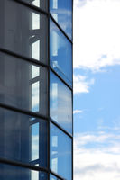 Large blue glass windows in the city shopping center and sky