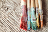 Close-up view of dirty paint brushes