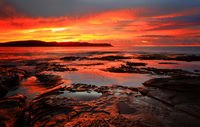 Red sunrise blankets Pearl Beach Australia