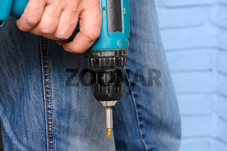 Worker holding the electric screwdriver