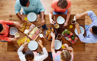 group of people having breakfast at table