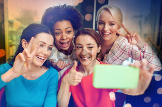 happy young women taking selfie with smartphone