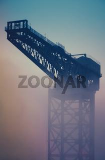 Industrial Crane At Sunrise In The Fog
