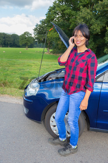 Woman with car failure phoning mobile