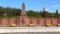 Moscow Russian Federation. The Moscow Kremlin orange sweepers go along the wall.