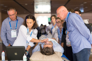 Participants learning new ultrasound techniques on medical congress.