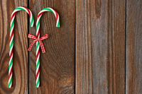 Christmas cane on wooden background