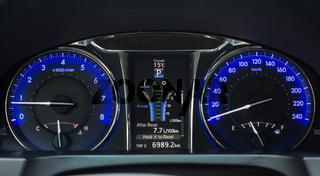 Screen with treap information on car dashboard.