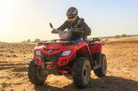 Ait Saoun, Morocco - February 22, 2016: Man riding buggy in desert
