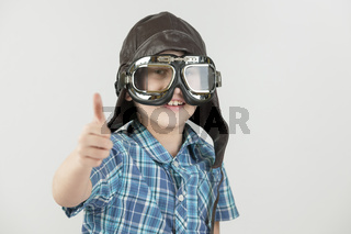 boy thumbs up with leather cap_horizontal