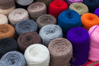 skeins of wool in street market