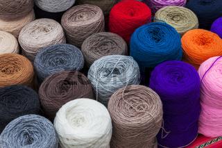 skeins of wool in street market