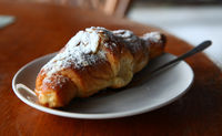 Appetizing Fresh Croissant On A Plate With Sugar Powder On Top