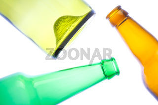 Empty wine and beer bottles on white background