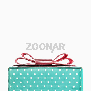 Gift box with a pink bow. Object isolated on white background. Conception: Congratulation, gift. Christmas, Valentine's Day, Happy Birthday