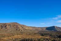desert valley in mountain landscape , clear blue sky background