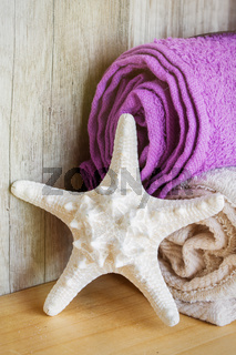 Towels with a starfish. Concept Beauty Health Spa and Wellness.