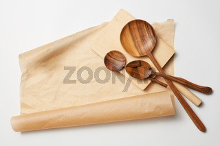 wooden spoons on baking paper