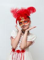 Adorable little girl with Venetian carnival mask