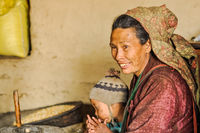 Smiling woman with child in Nepal