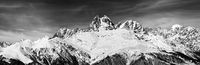 Black and white  panoramic view on Mount Ushba at wind sunny day