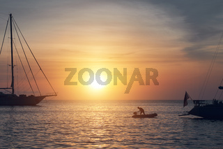 Vessels at Cala Saona in Formentera during sunset. Balearic Islands. Spain