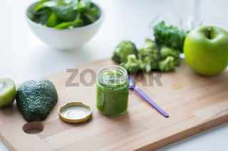 jar with puree or baby food on wooden board