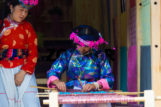 Lijiang Woman Traditional Garb Naxi Weaving Loom