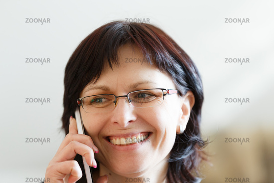 smiling middle-aged woman call by phone