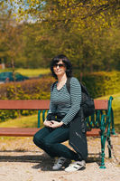 tired Middle age woman resting on bench