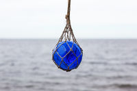 Glass buoy hanging in a net