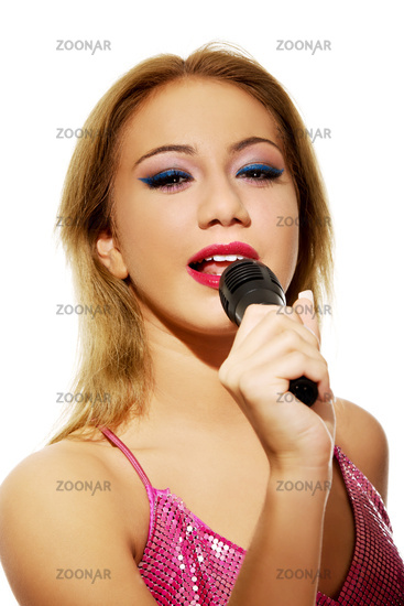 Young beautiful pop singer.