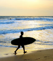 Boy surf beach silhouette surfboard