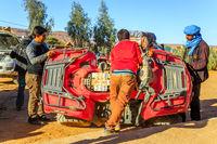 Ait Saoun, Morocco - February 23, 2016: Mechanic repairing desert bike