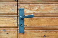 Old wooden door and door handle with lock