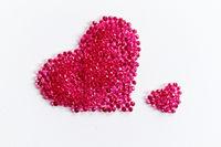 Pink hearts on white background - macro photo