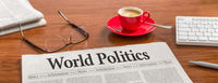 A newspaper on a wooden desk - World politics