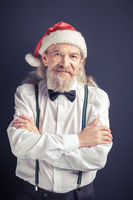 Old man wearing Santa hat.