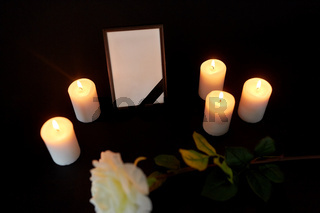 photo frame with black ribbon, flower and candles