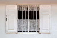 White painted window wooden wall texture background.