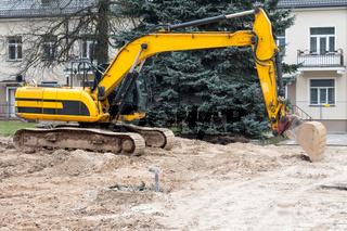Yellow excavator machine