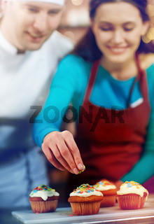 happy woman and chef cook baking in kitchen