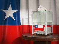 Ballot box with flag of Chile and voting papers. Chilean presidential or parliamentary election or referendum.